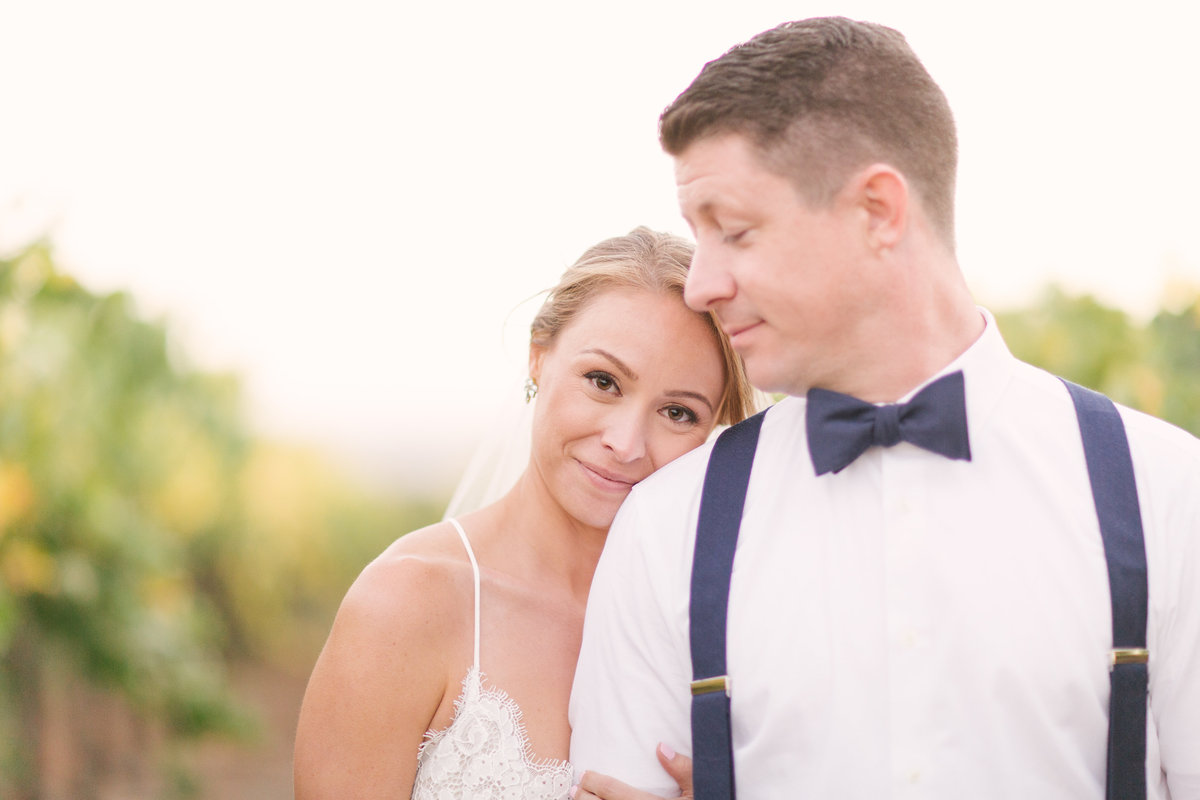 Groom gazes at bride after wedding ceremony at Firestone Vineyard
