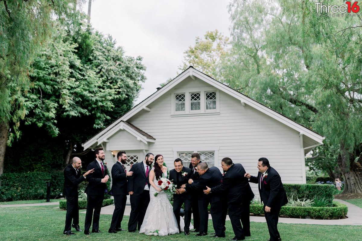 Groomsmen share a laugh with the Bride and Groom