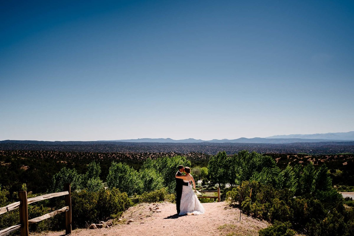 bride and groom on hills at at Four Seasons Resort Rancho Encantado Santa Fe