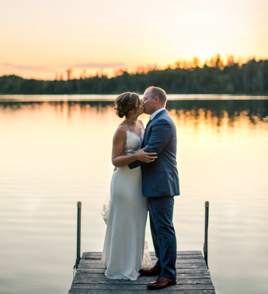 small intimate wedding on gull lake summer sunset light over the water