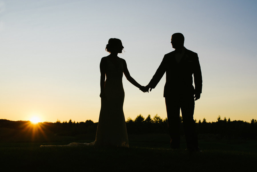 silouette wedding photo at sunset