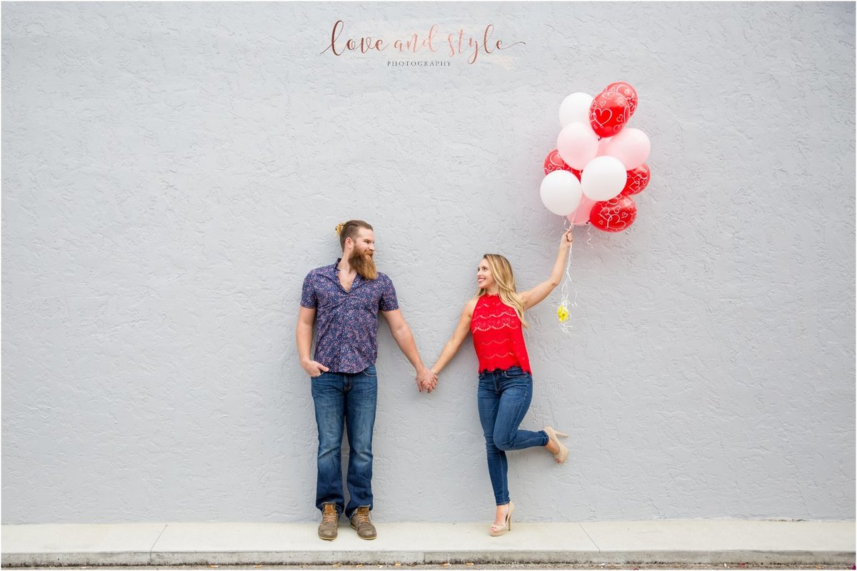 Sarasota Engagement Photography with red and pink balloons downtown