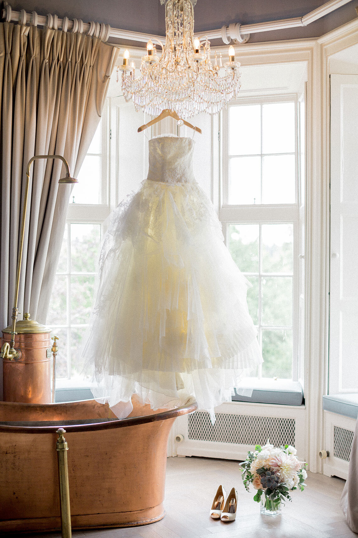 Ireland & US Wedding Planner, dress hanging up in window
