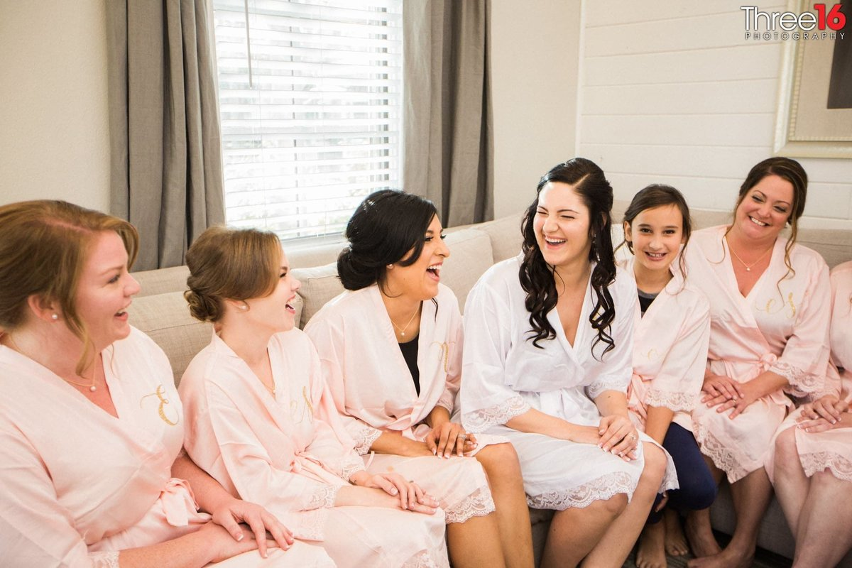 Bride sharing a laugh with her bridesmaids