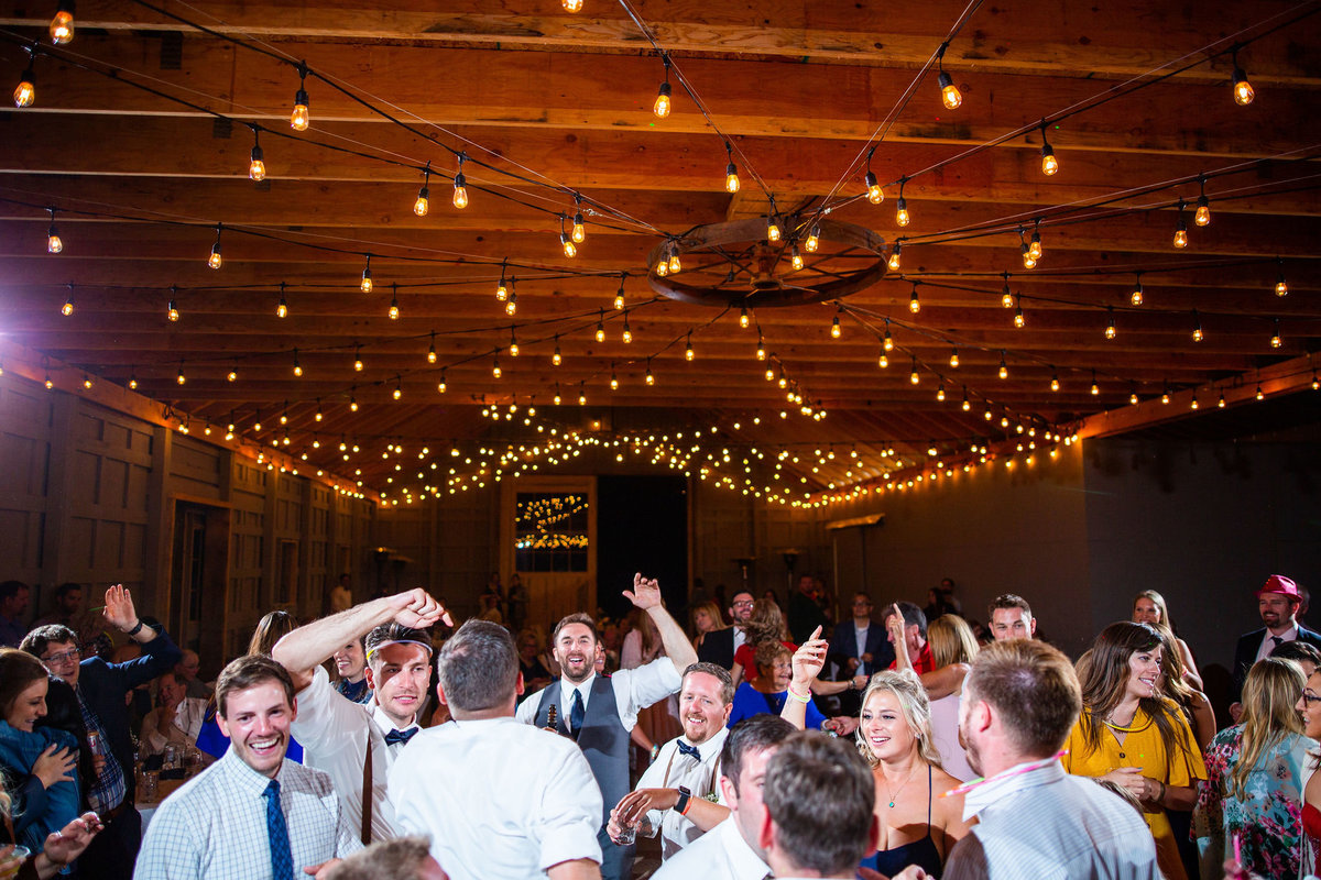 Strawberry-Creek-Ranch-Wedding-Ashley-McKenzie-Photography-Summer-love-on-the-ranch-Dancing-with-Market-lights