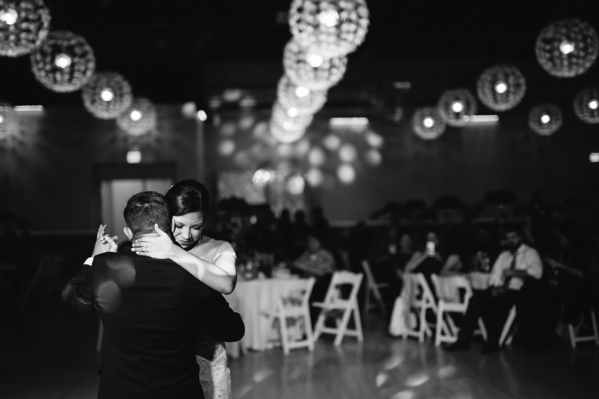 bride and groom wedding first dance black and white at Pica Pica Event Center reception hall San Antonio, Texas
