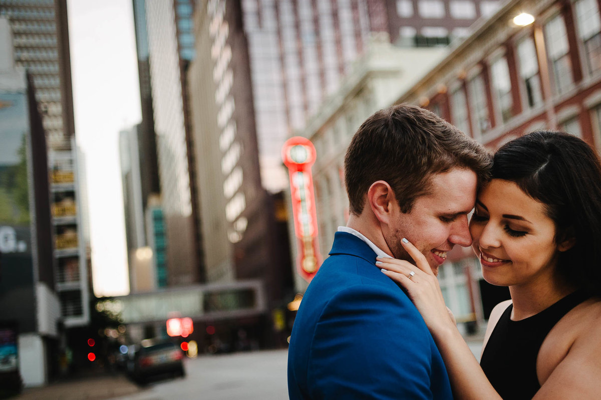 couple kissing by the majestic in dallas during their engagement session