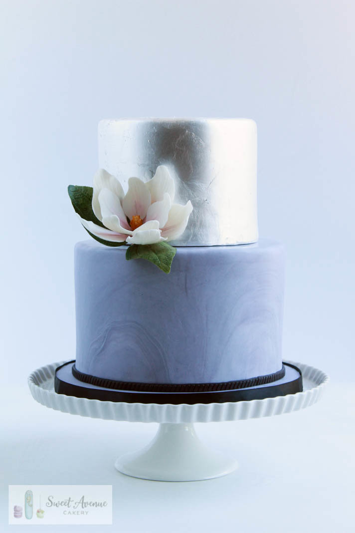 marble and silver leaf wedding cake with sugar magnolia
