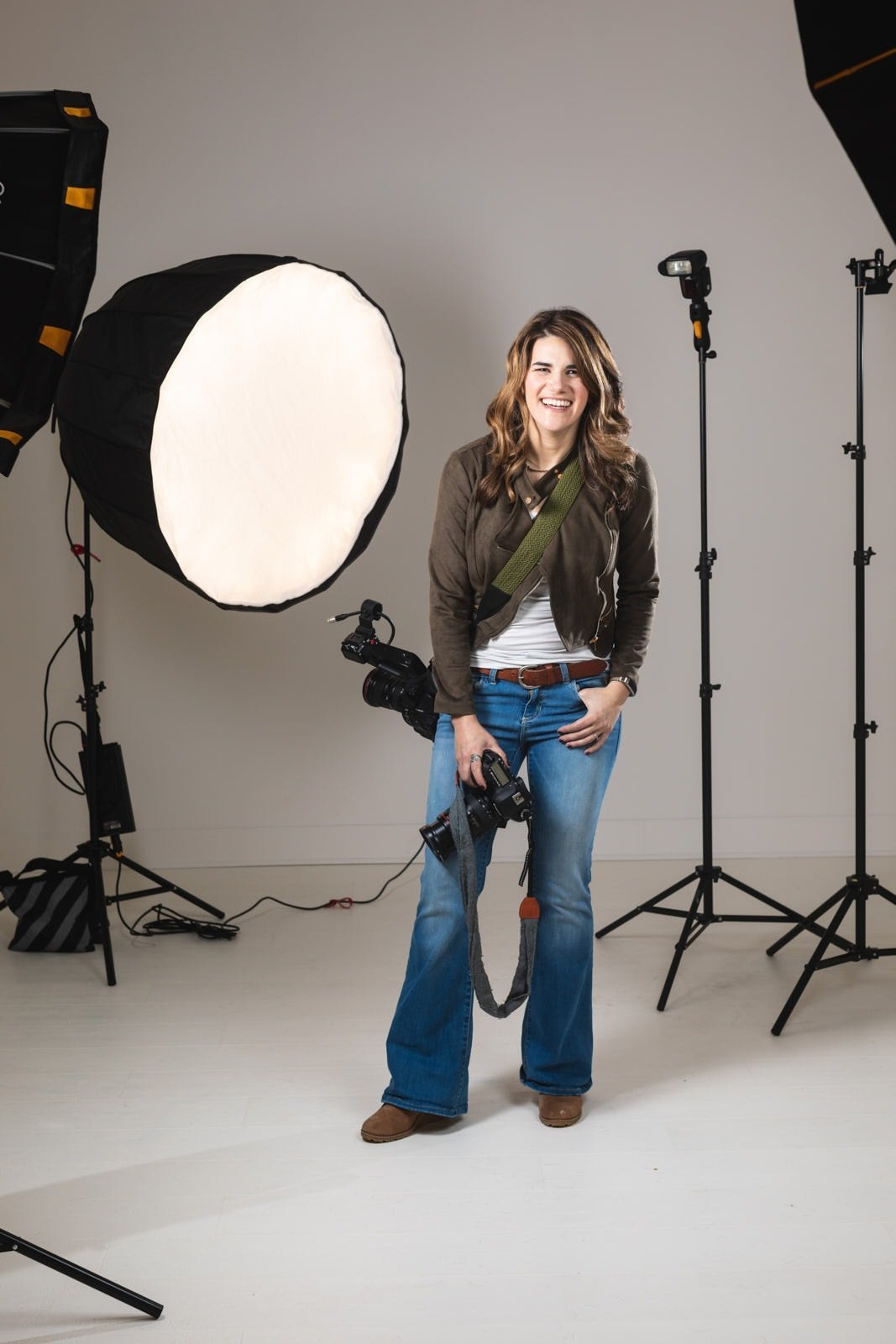 photographer laughing with studio flash equipment in White Wall Studio Woodstock