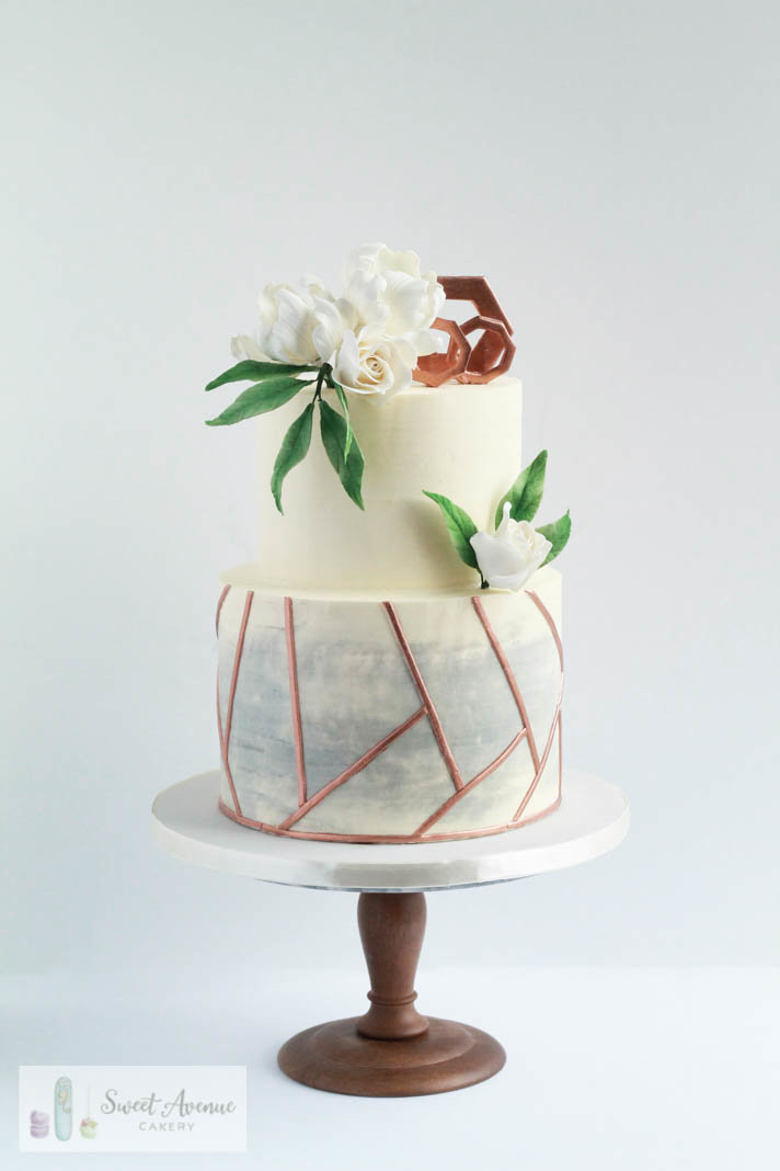 marble and gold wedding cake with flowers