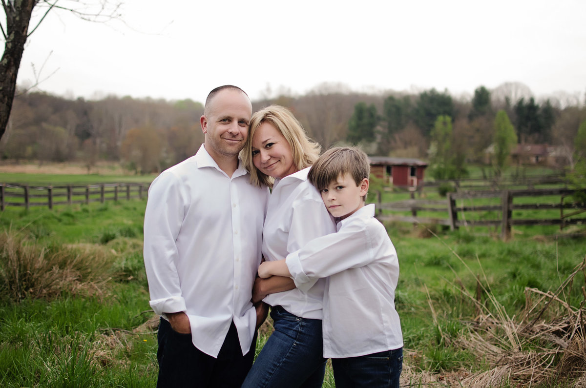 Portrait of a family of three in white  during a lifestyle session taken by Sarah Alice Photography in Northern Virginia