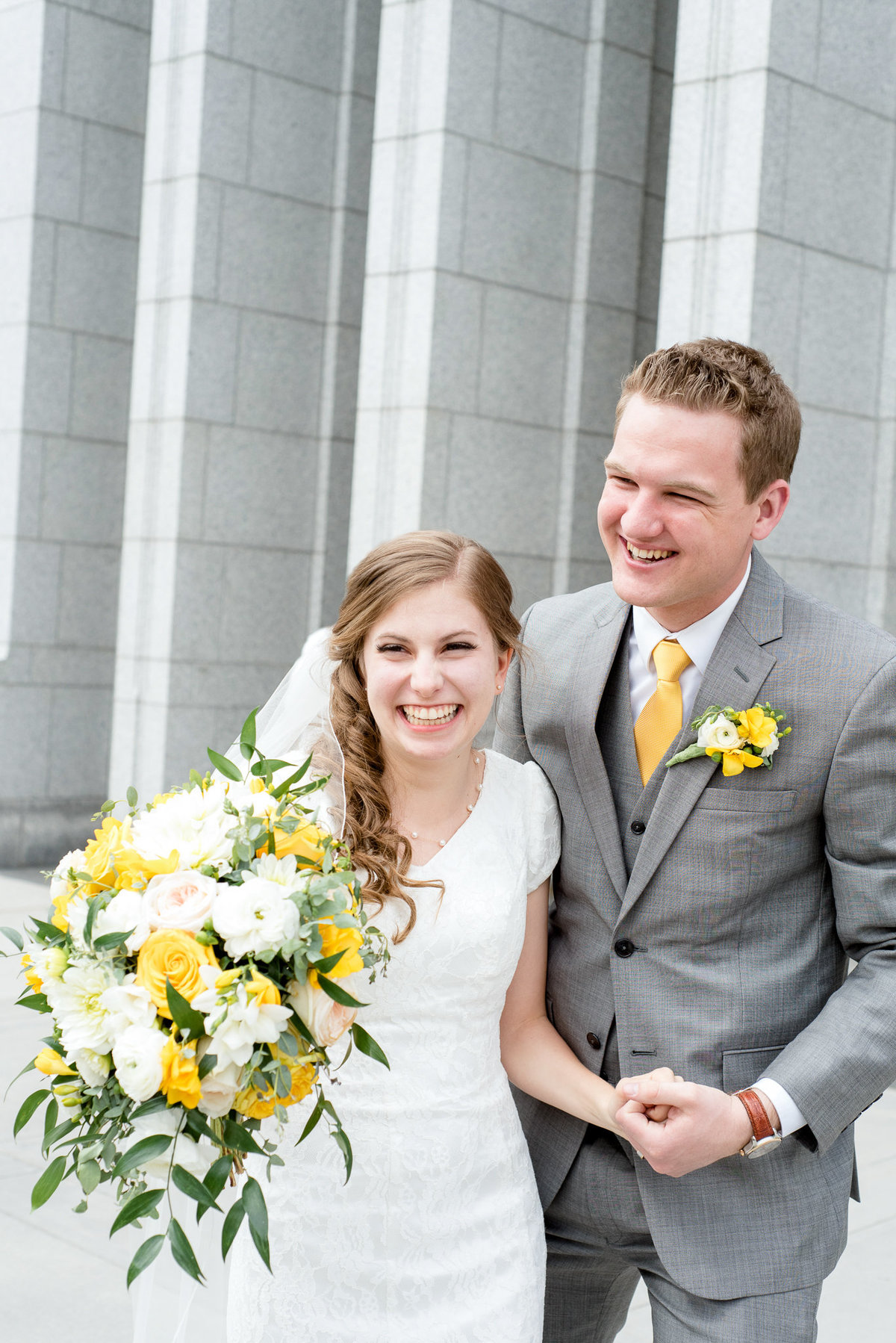 Bride and groom smile as they exit the Draper Utah Temple