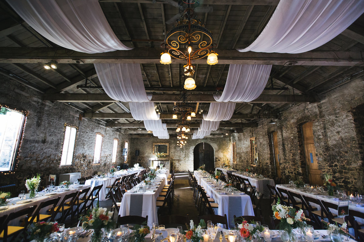 Miners Foundry Stone hall with draping wedding reception