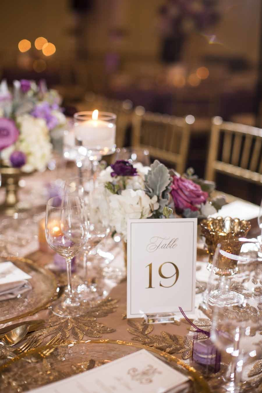 Luxurious gold and purple place setting  at this Seattle Wedding Reception