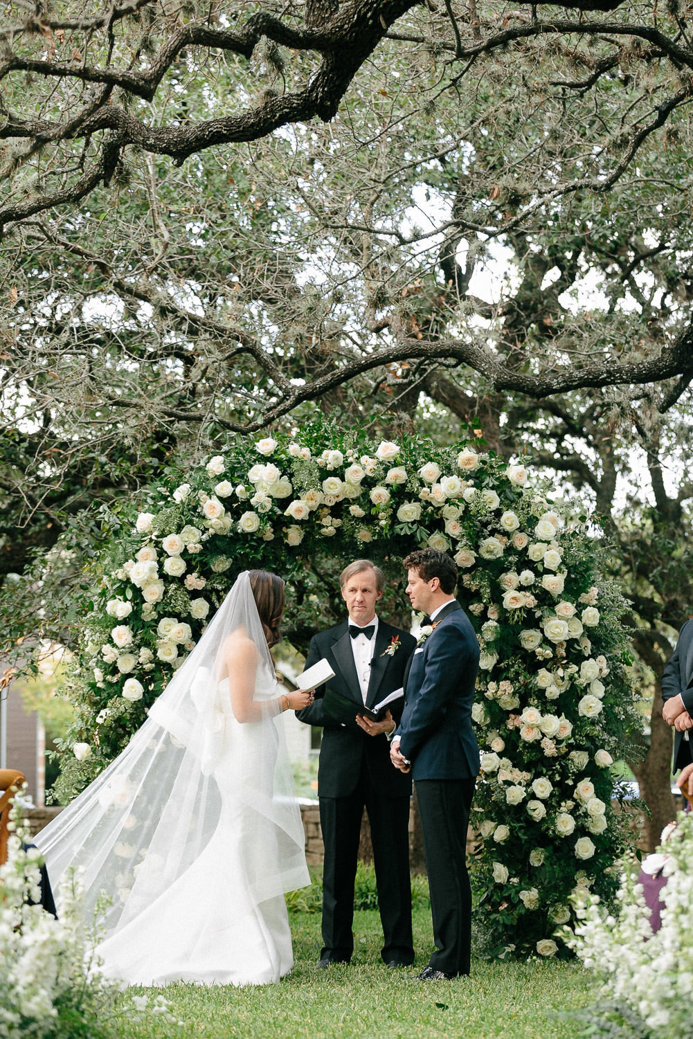 bride reading vows to groom during wedding ceremony altar Matties Austin