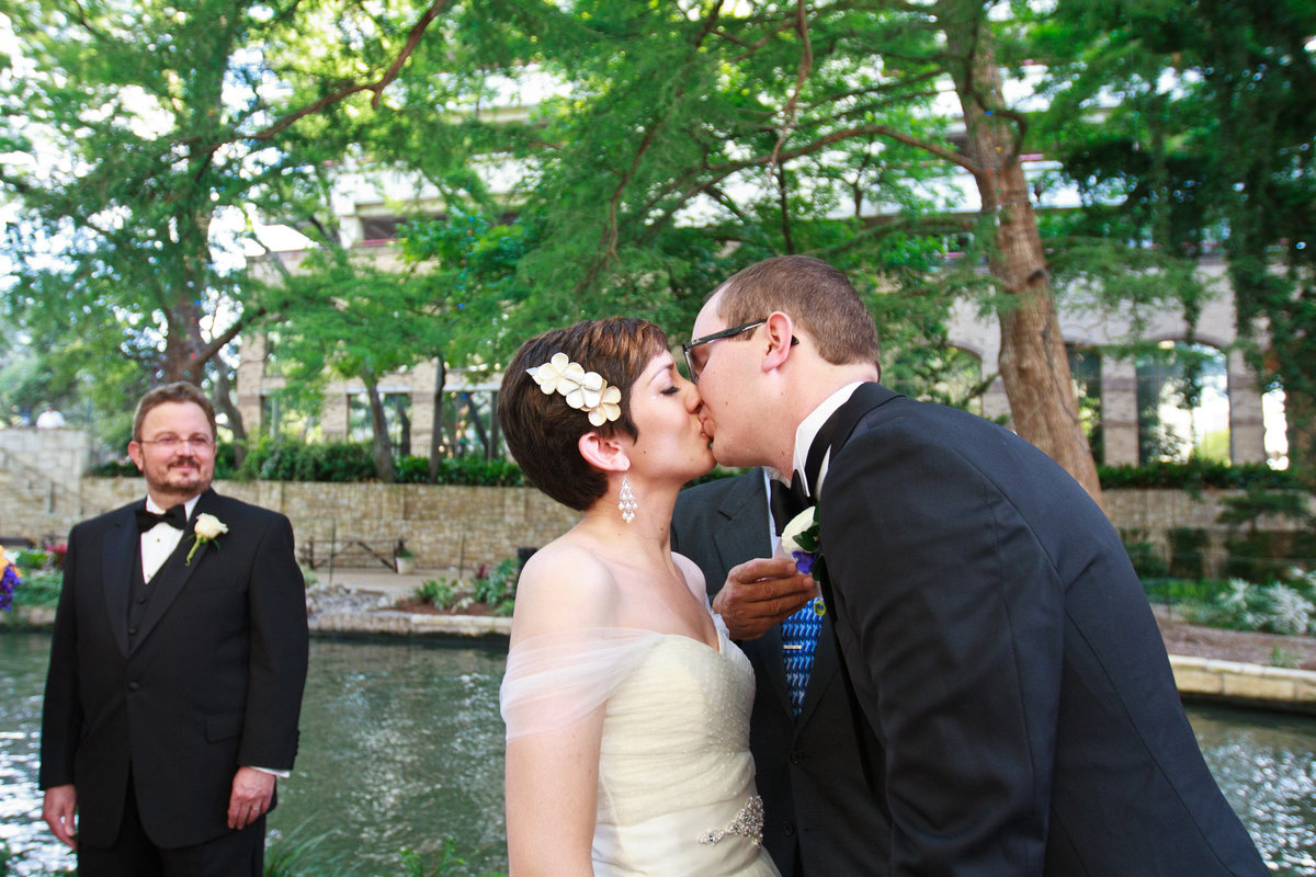 bride and groom kissing at wedding ceremony site downtown san antonio marriage island the contessa hotel riverwalk