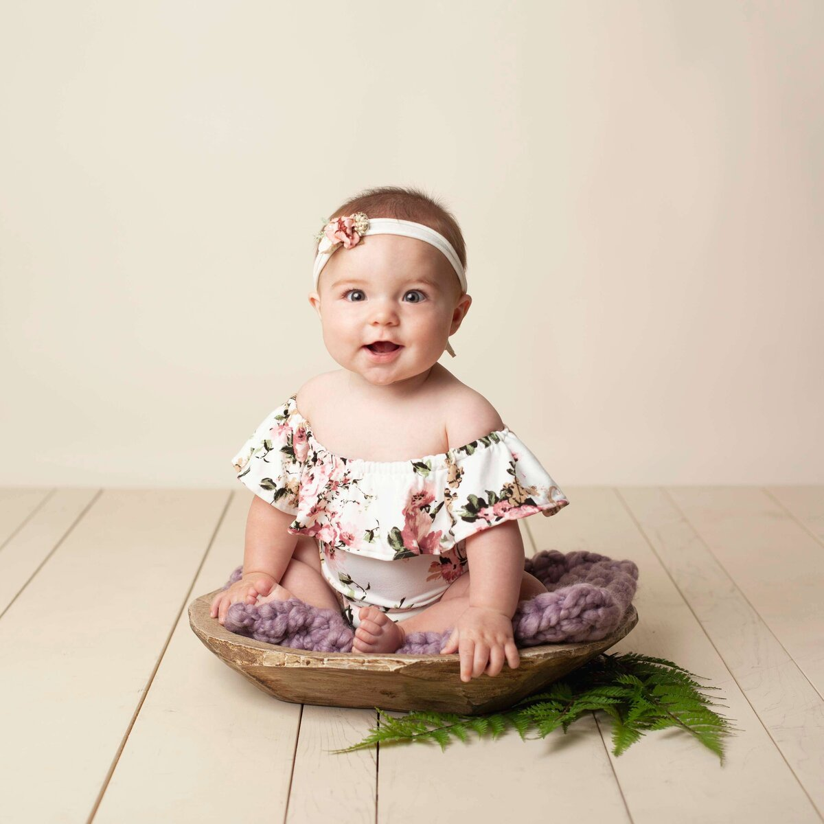 milestone baby sitter session flower outfit and headband in wooden bowl prop