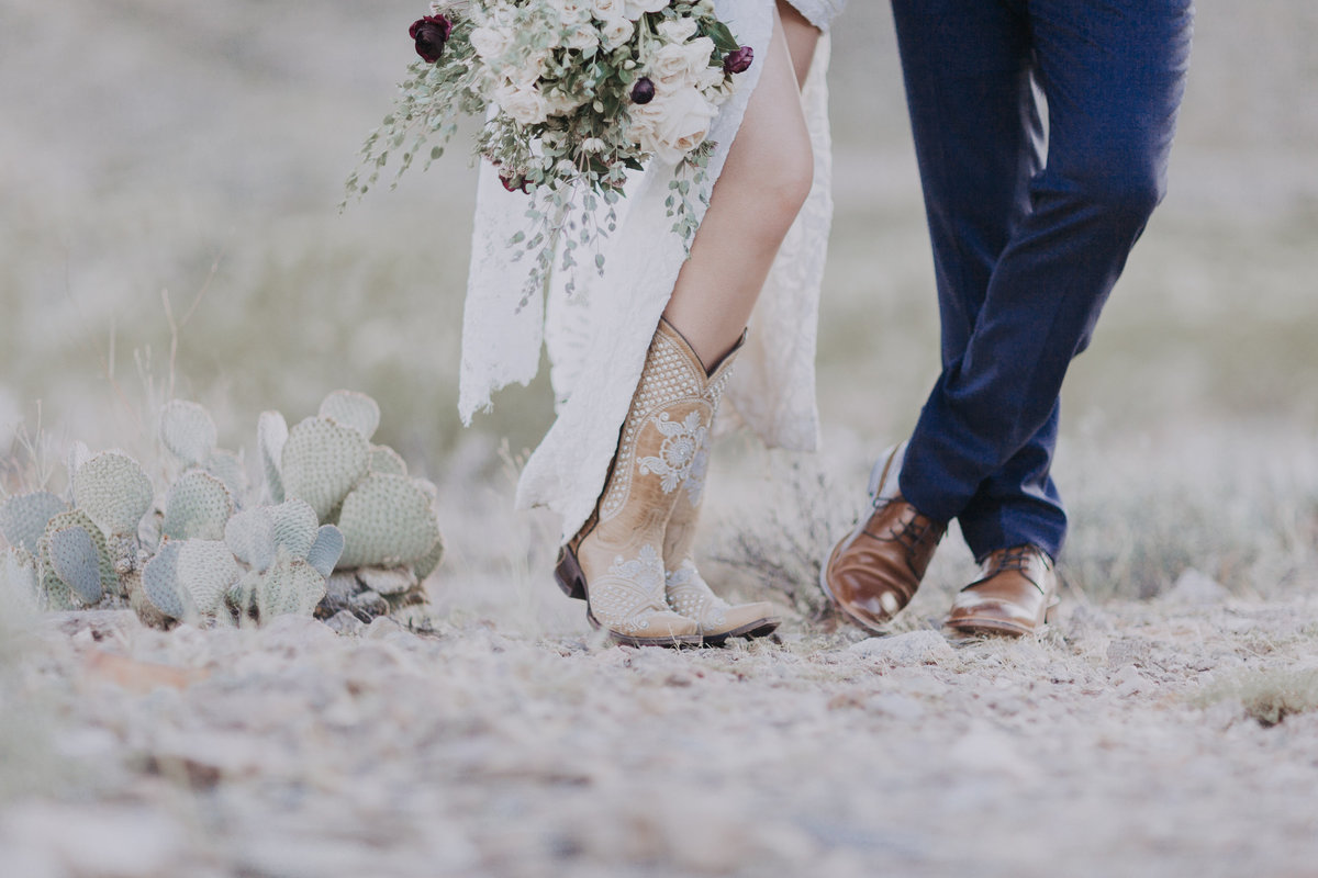 Lake Tahoe elopement pictures close up of bride's boots and groom's shoes near cacti