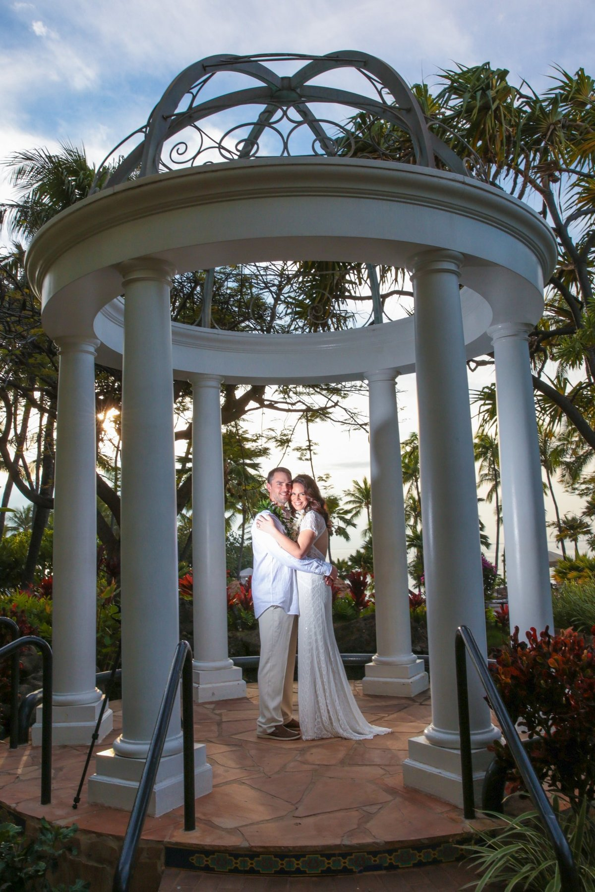 Maui Wedding Photography   at The Westin Maui Resort and Spa  with the bride and groom at sunset in the wedding gazebo