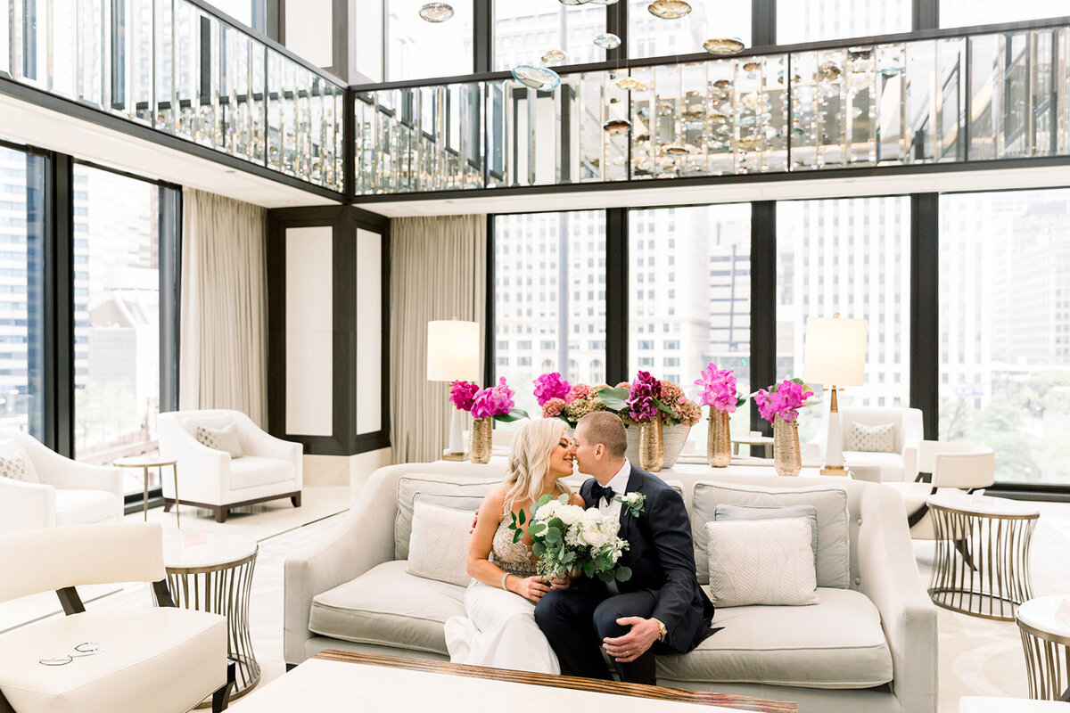 bride and groom kissing in Langham lobby downtown