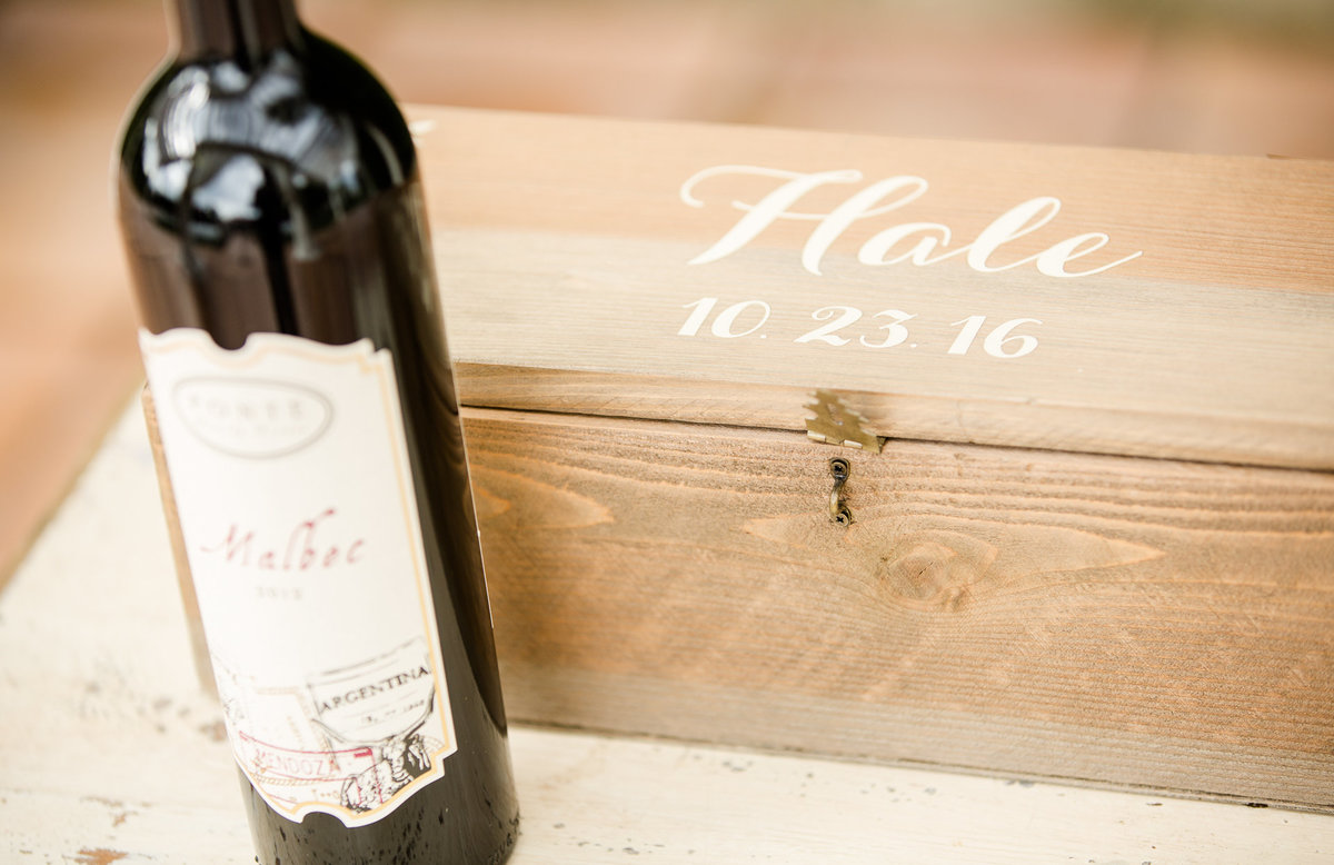 Red wine next to a couple's keepsake box prior to their wedding ceremony at villa de amore by matty fran photography