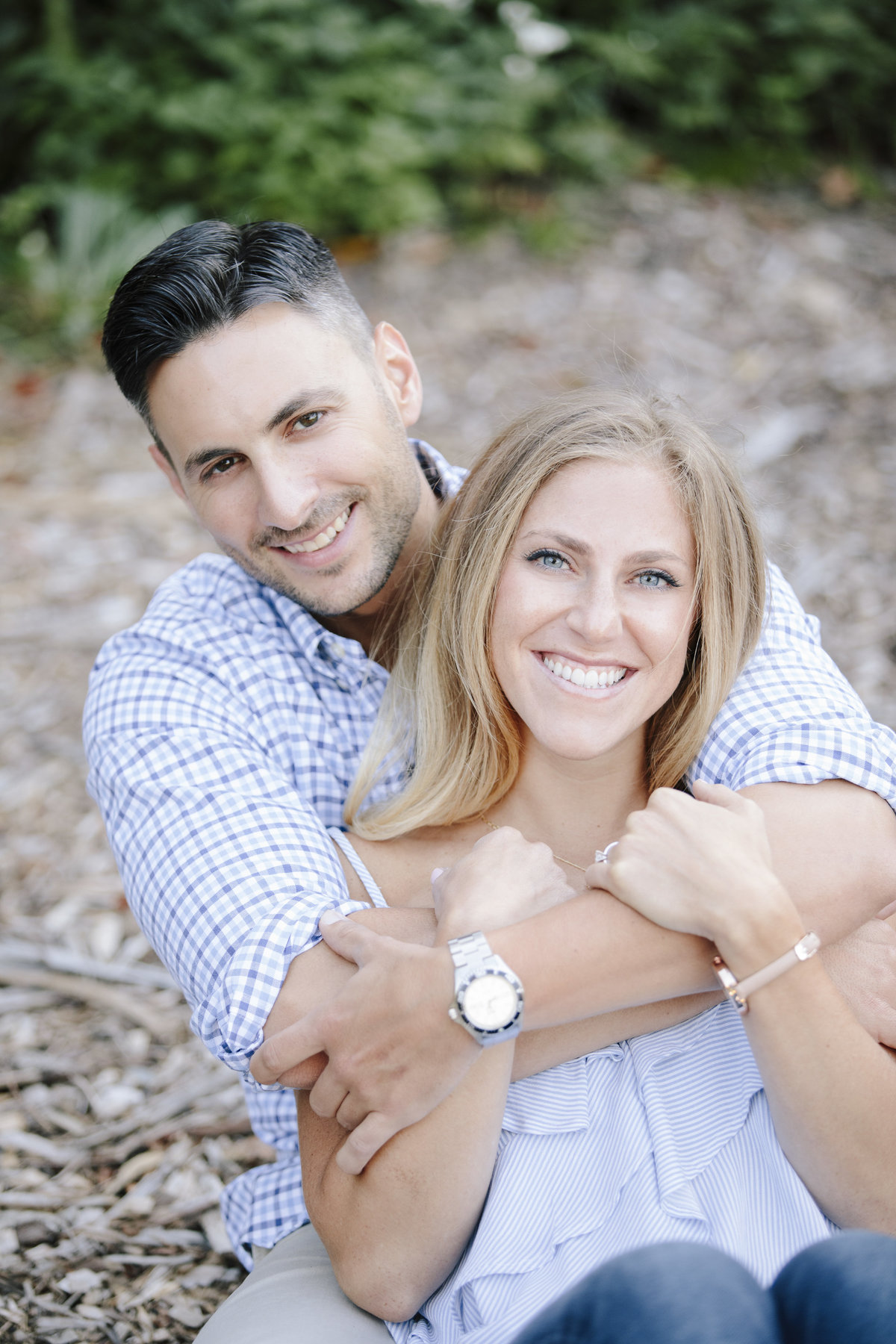 engaged couple sits together at laurtia winery
