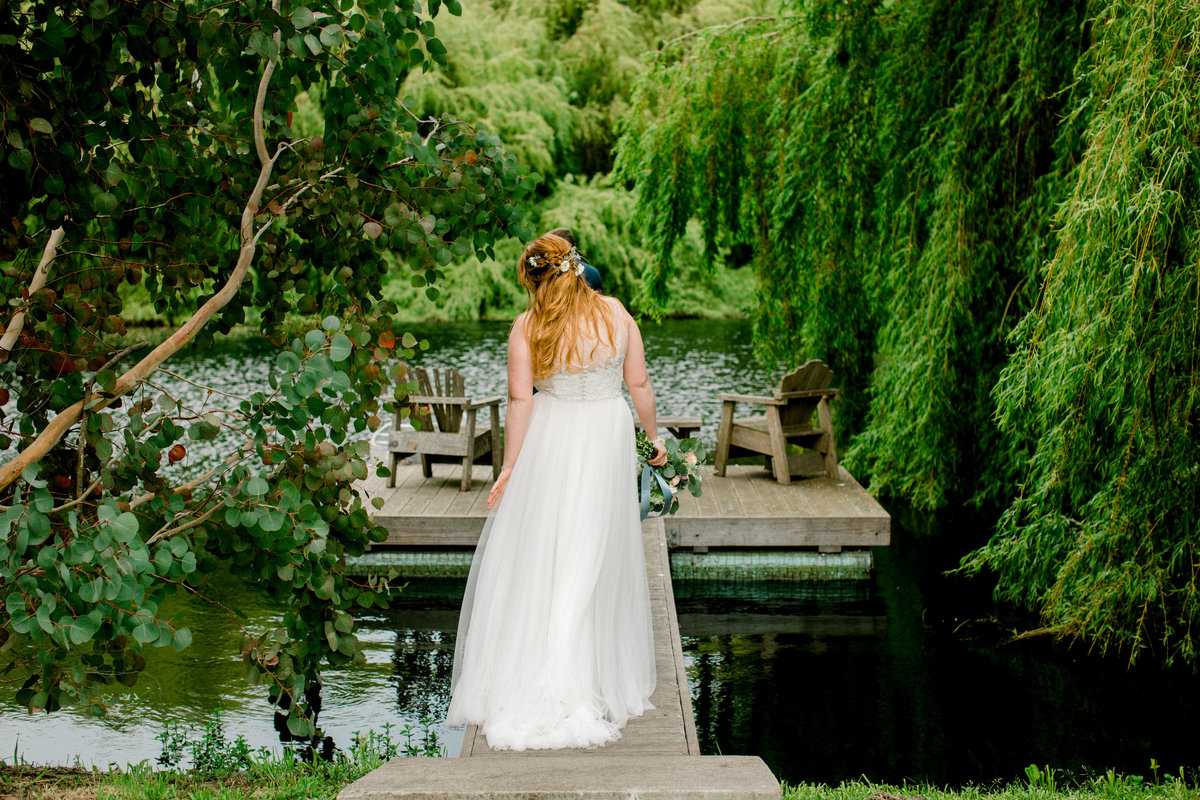 Bride walking to the dock at Olympias Valley Estate in Petaluma California