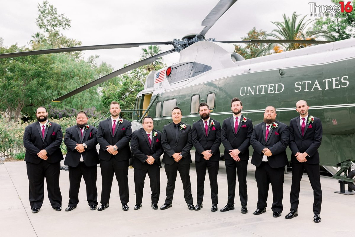 Groom and his Groomsmen pose in front of the helicopter at the Richard Nixon Library