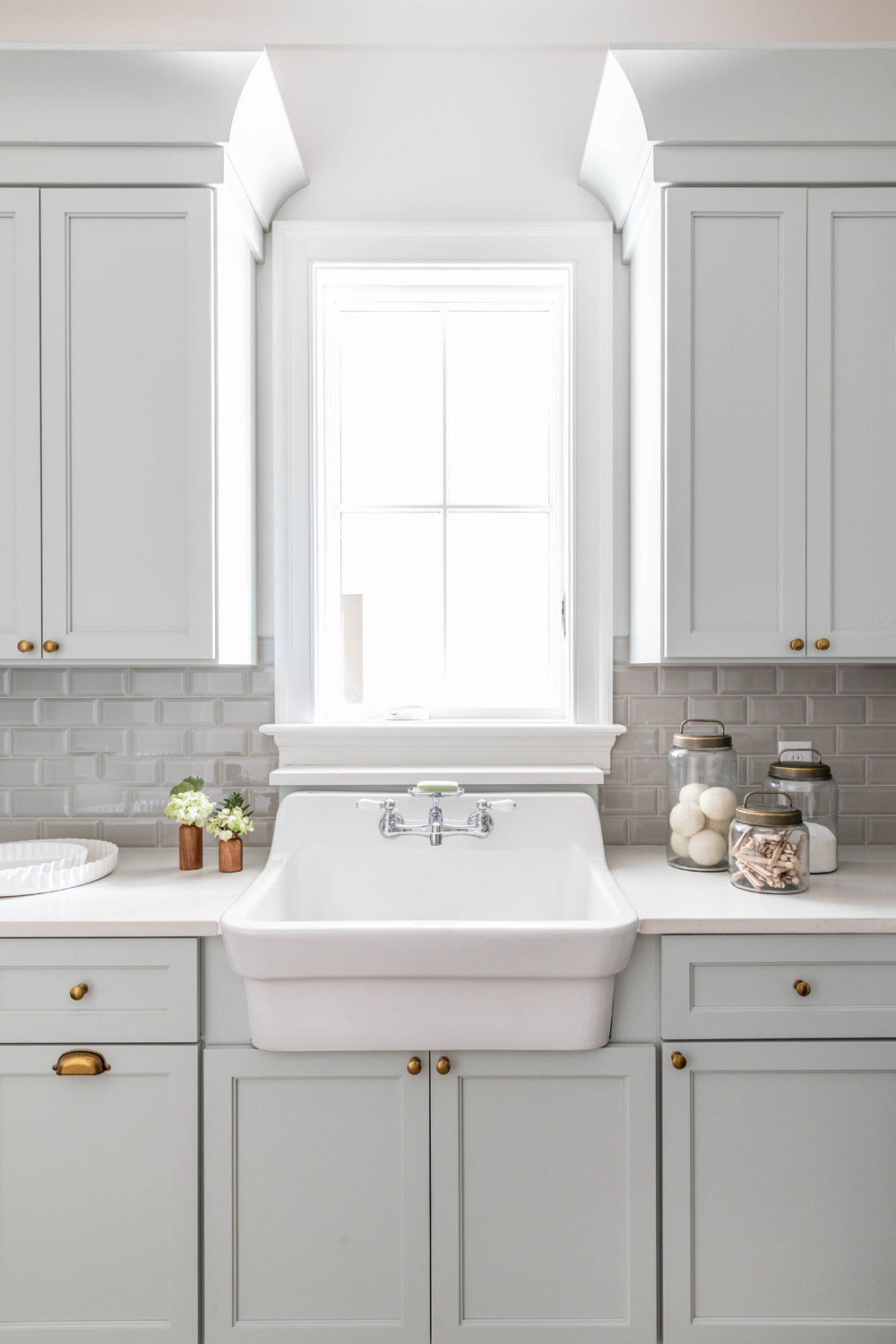 Sherwin-Williams-Silver-Strand-Laundry-Room-with-Kohler-Utility-Sink-and-Brick-Herringbone-Floor-2