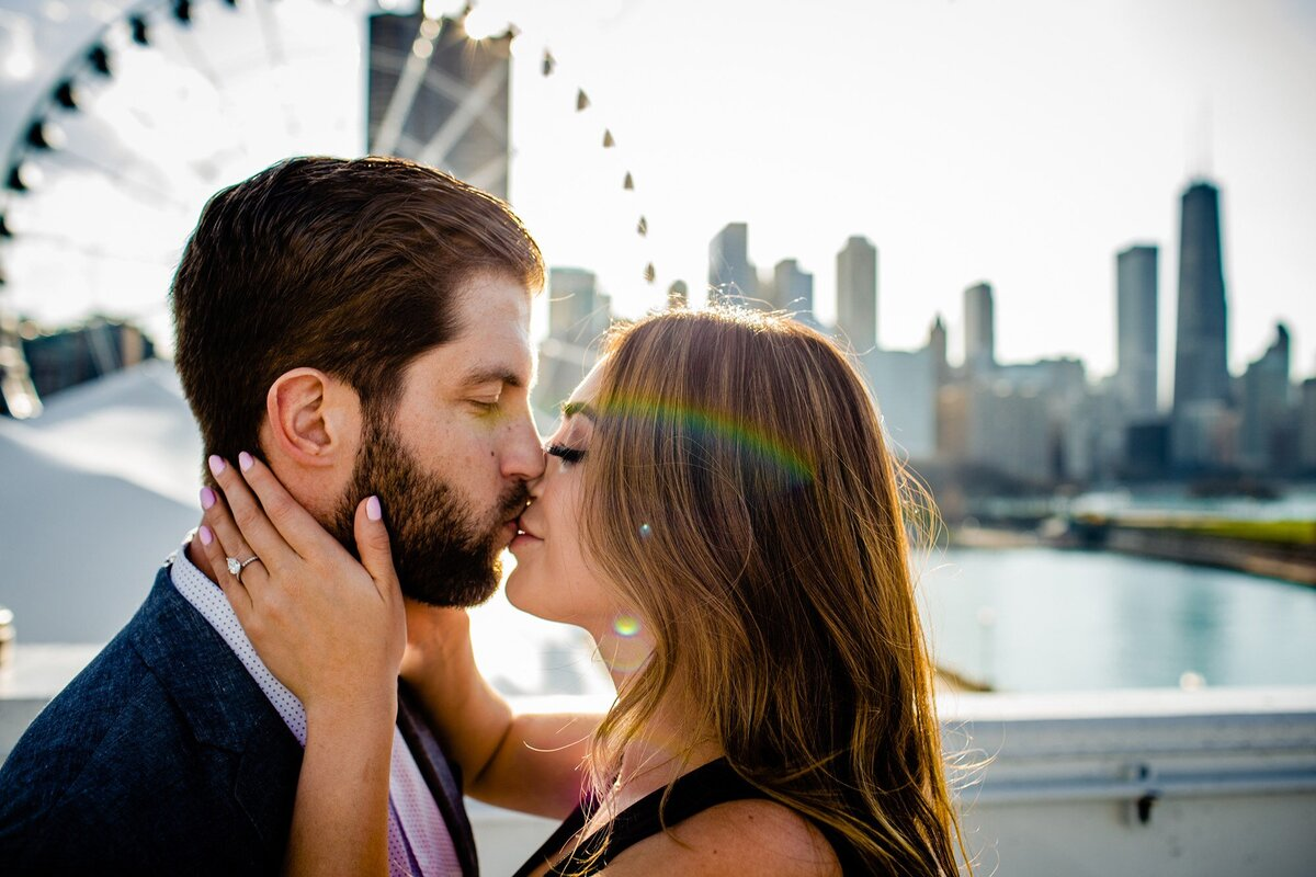 A couple kissed during a Navy Pier engagement session.