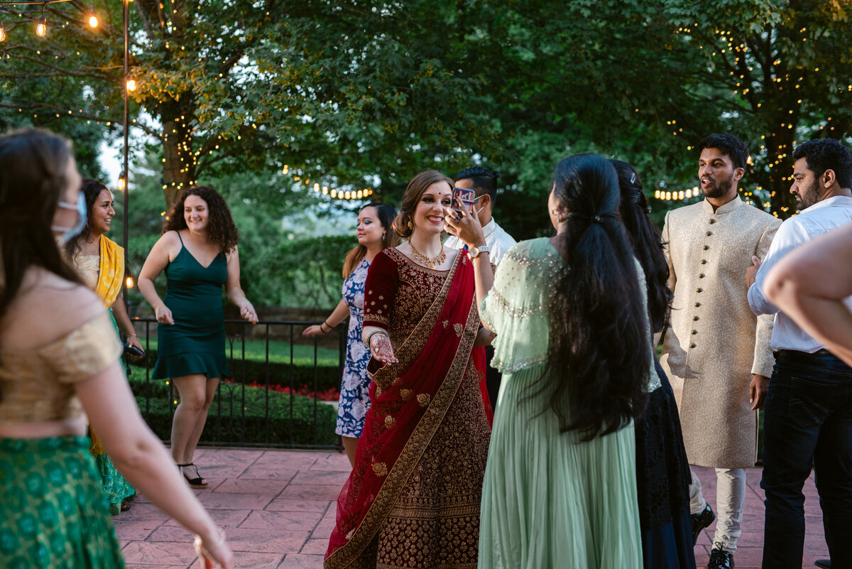 Bride in Lehnga dancing during the reception with her friends.