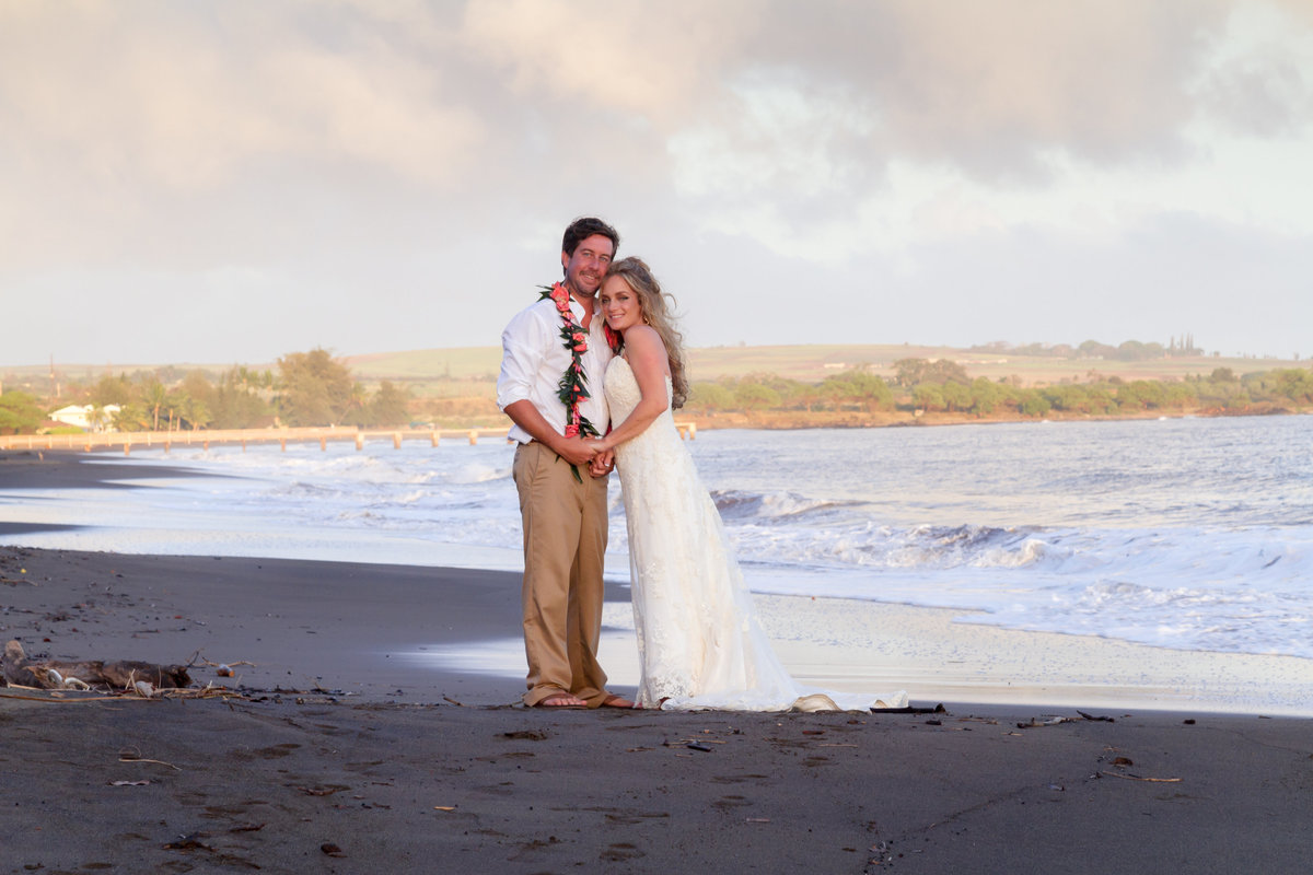 Bride and groom on the beach in Waimea Kauai.