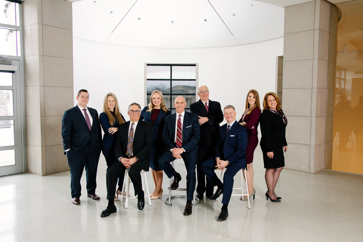 Business headshot of team of employees in reception