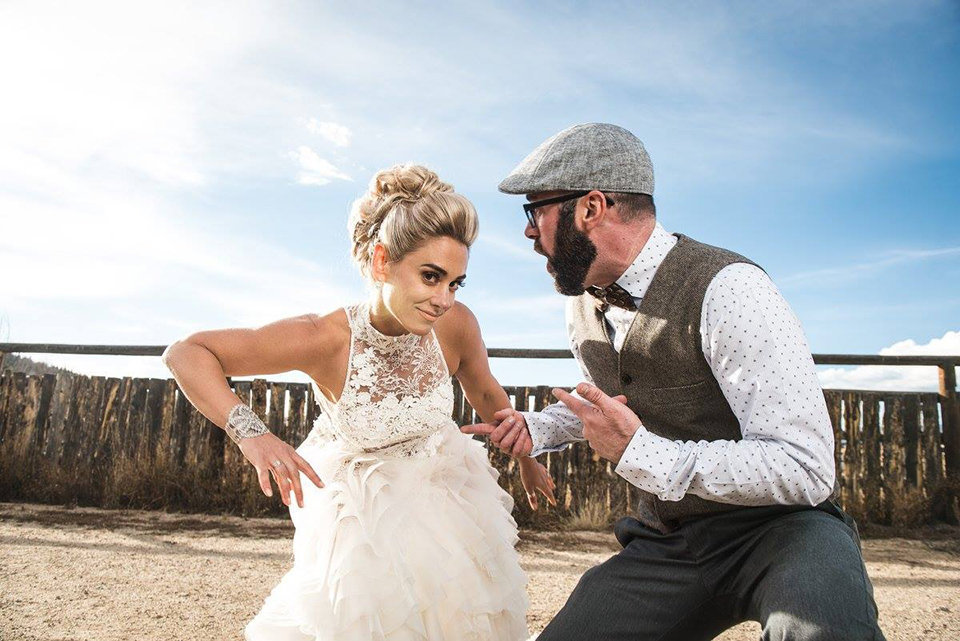Granby-colorado-strawberry-creek-ranch-hipster-mountain-wedding-married-couple-goofing-around