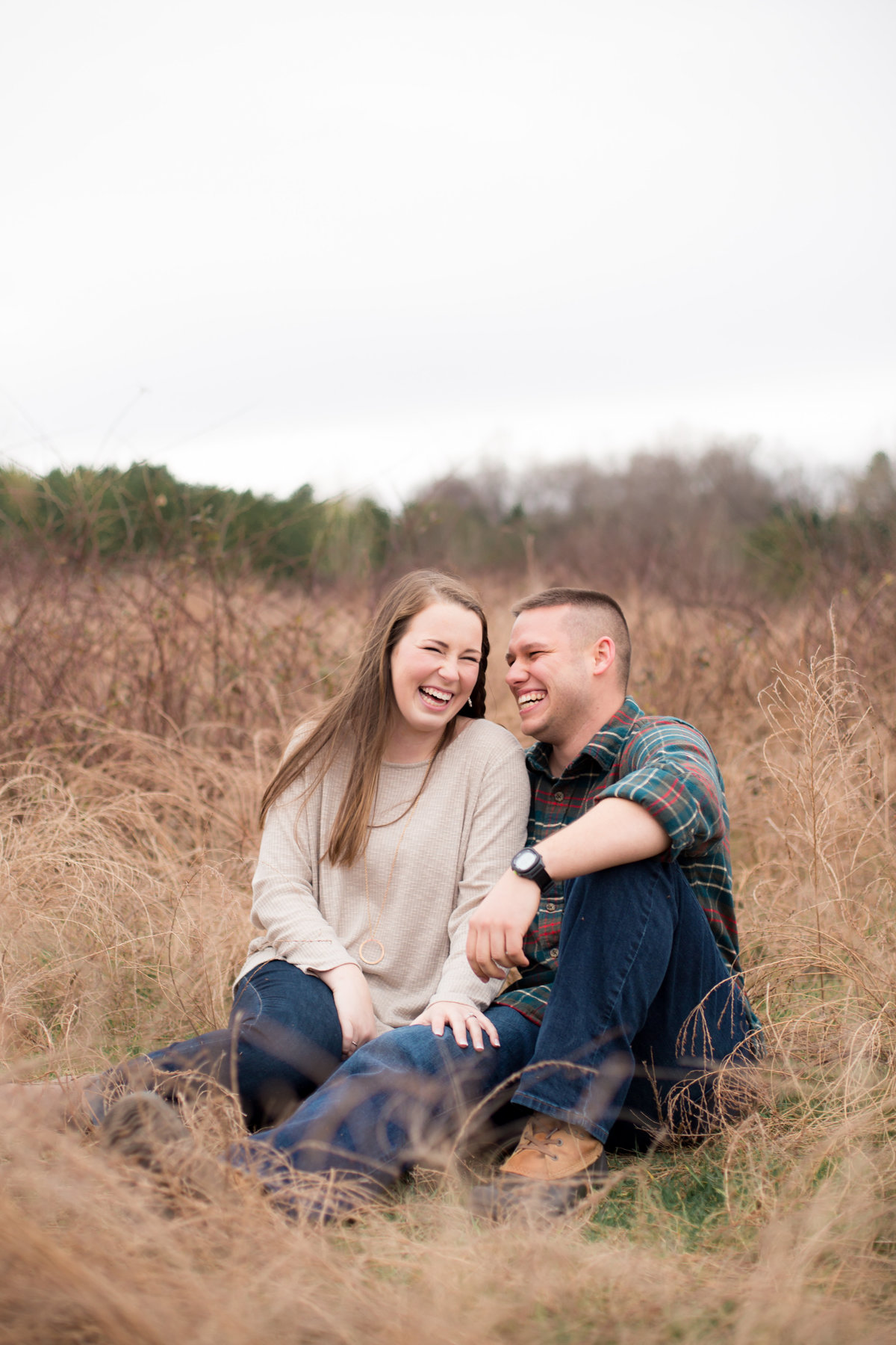 engaged couple laughing in outdoor wedding photographer shoot