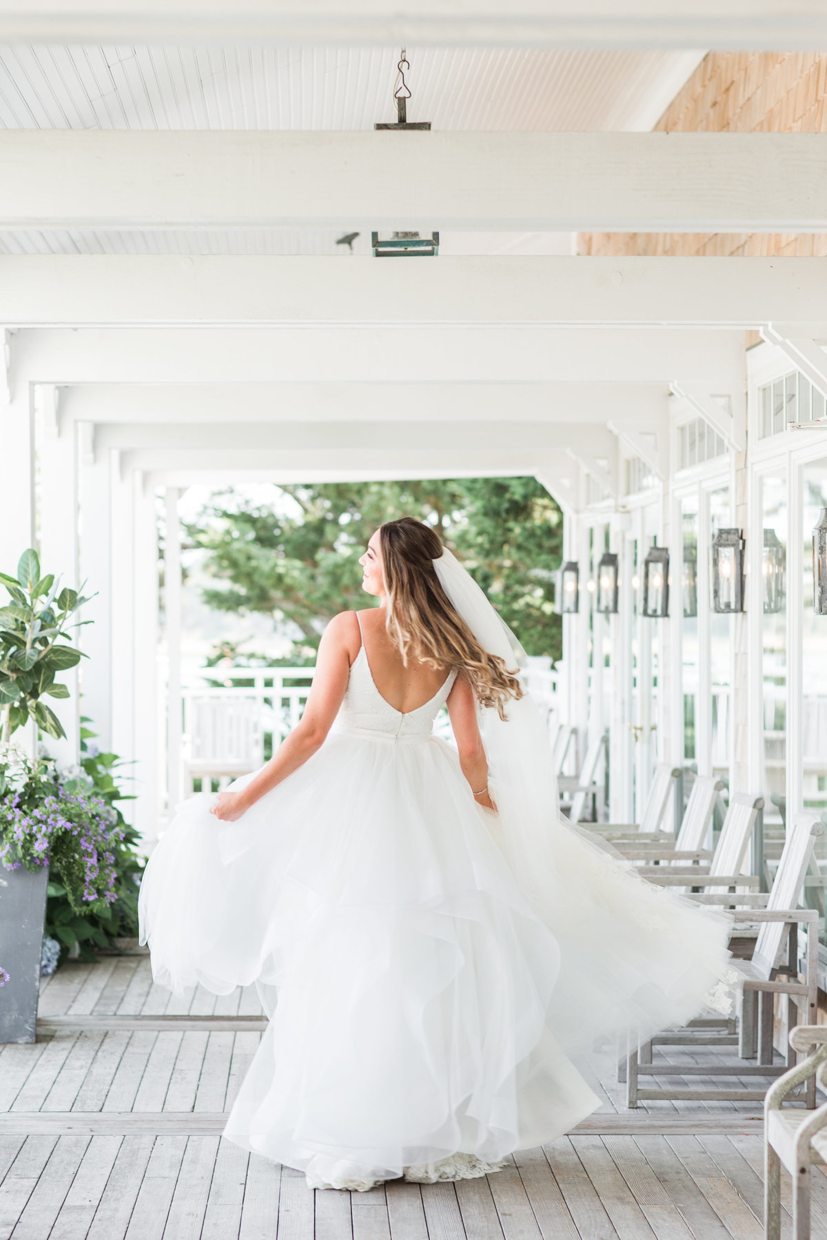 Bride twirling in her dress at Wequassett Resort and Spa