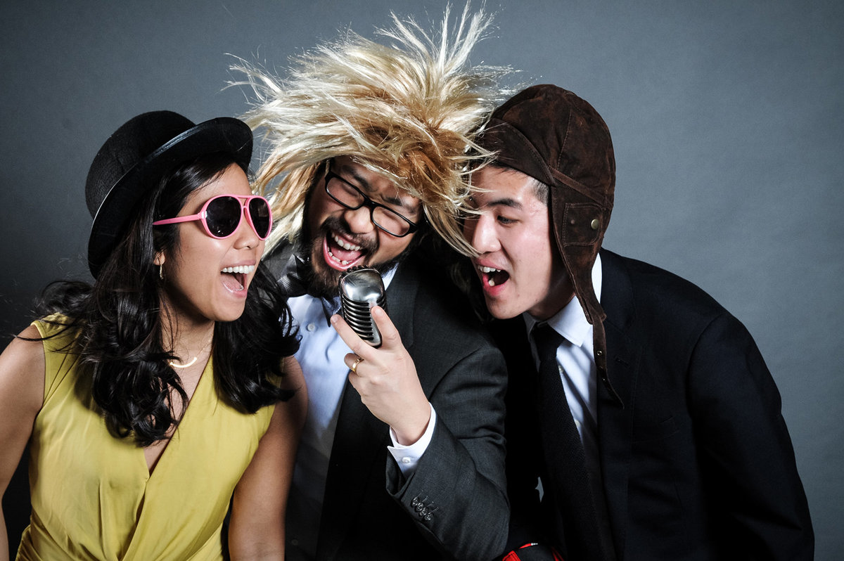 0009-Photo-Booth-Rental-at-Wedding-Reception-Guests-Having-Fun