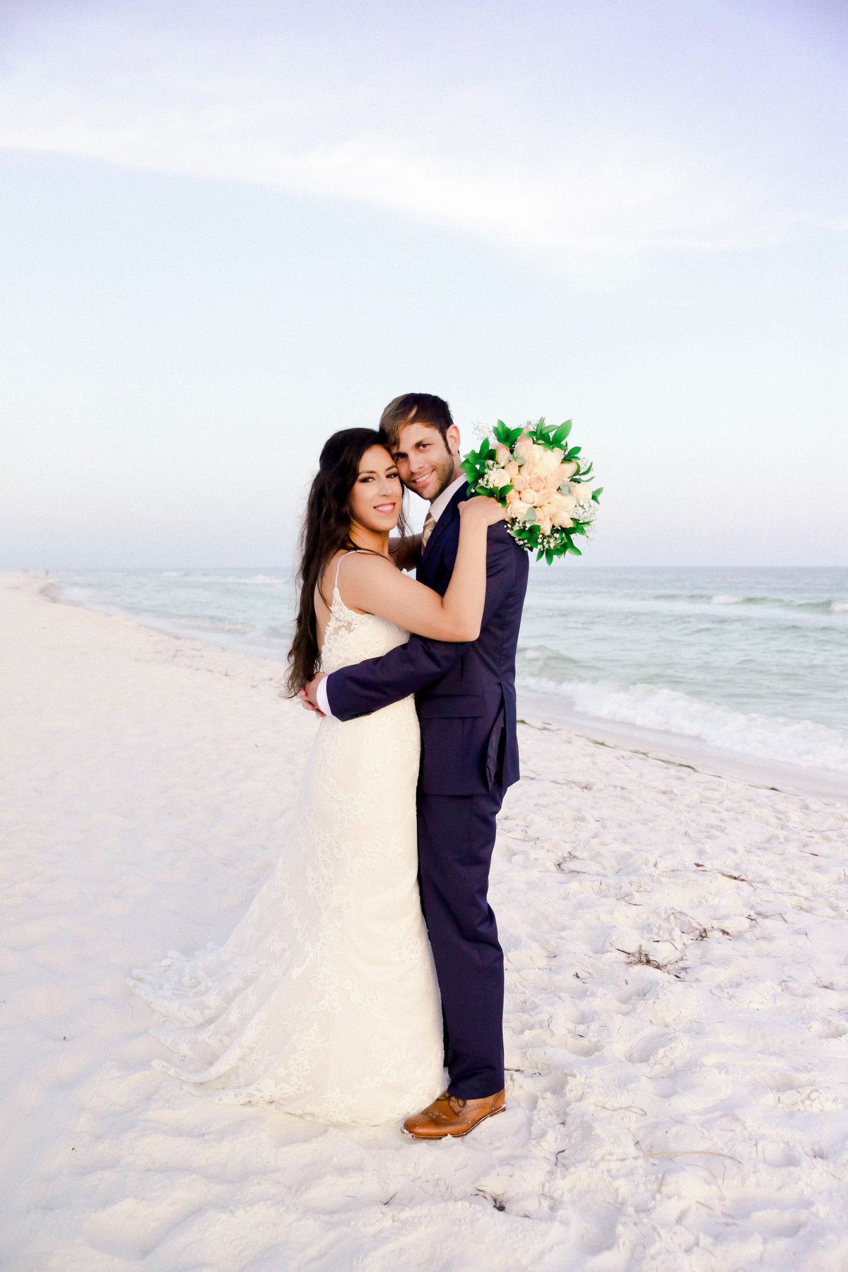 Bride and Groom holding each other on the beach in Destin, FL