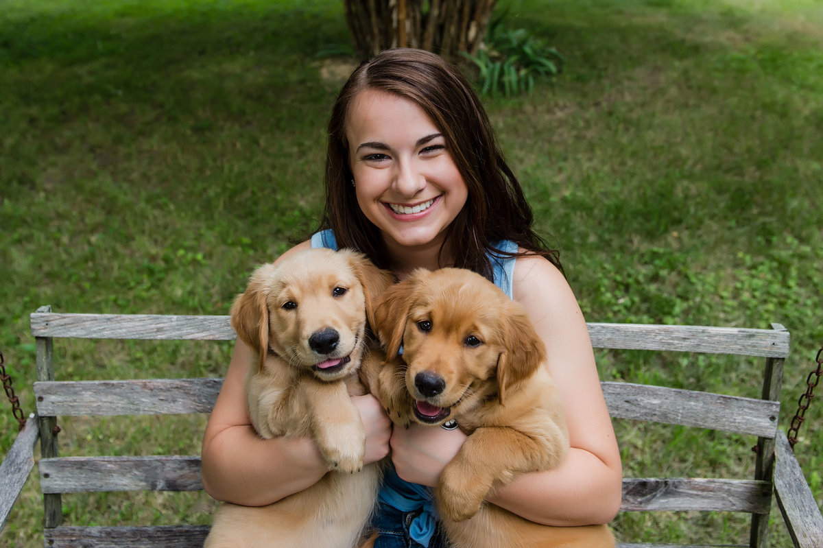 girl with golden retrievers