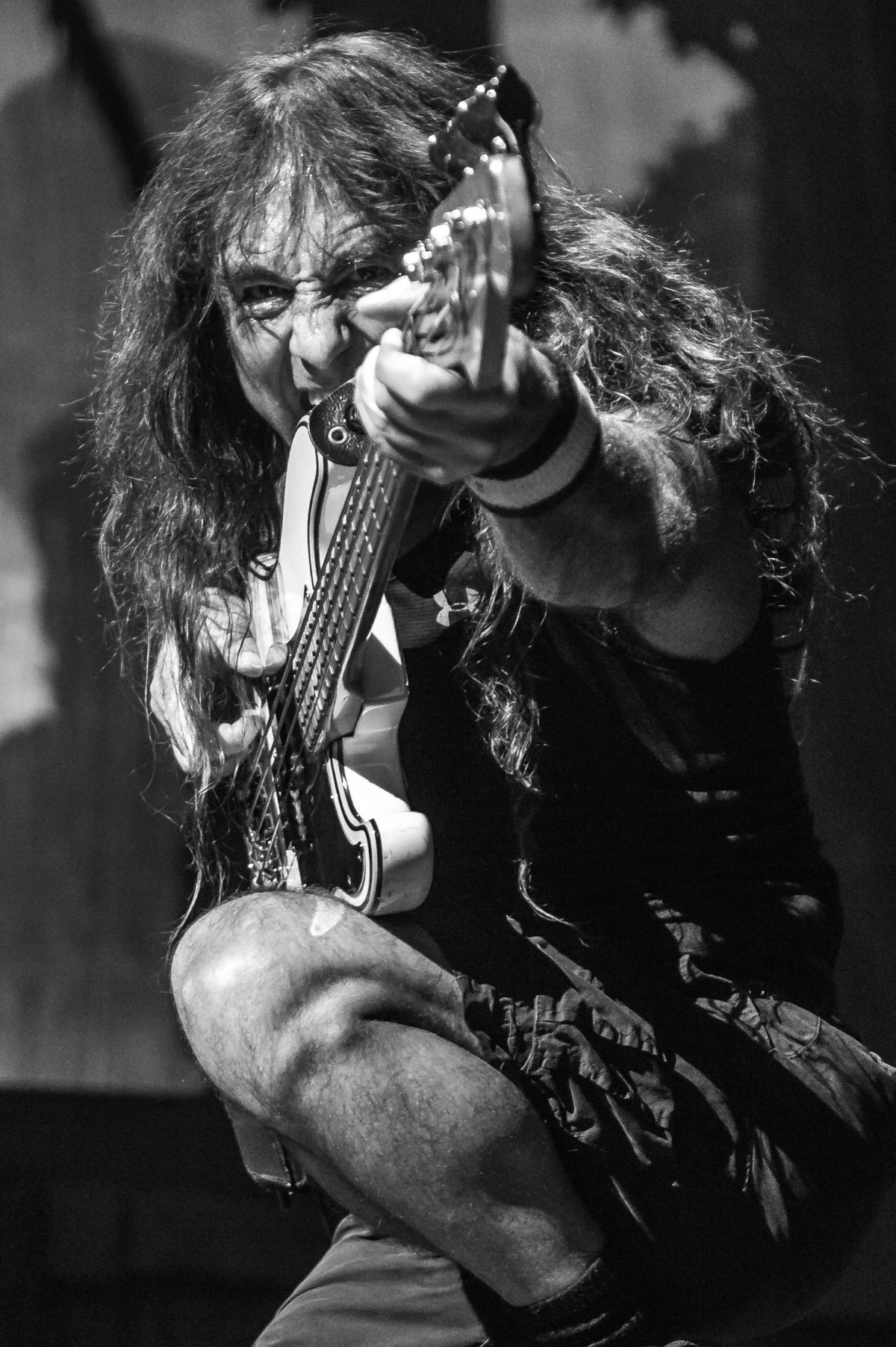 Steve Harris of Iron Maiden pointing guitar at camera