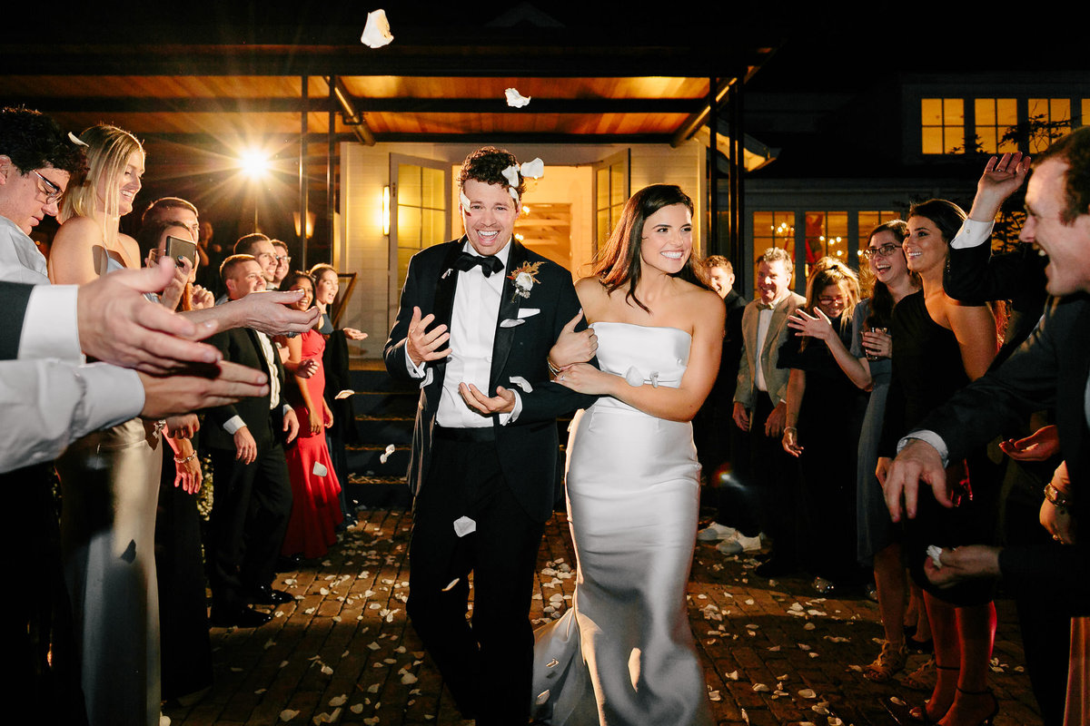 bride and groom flower petal toss reception exit matties wedding venue austin