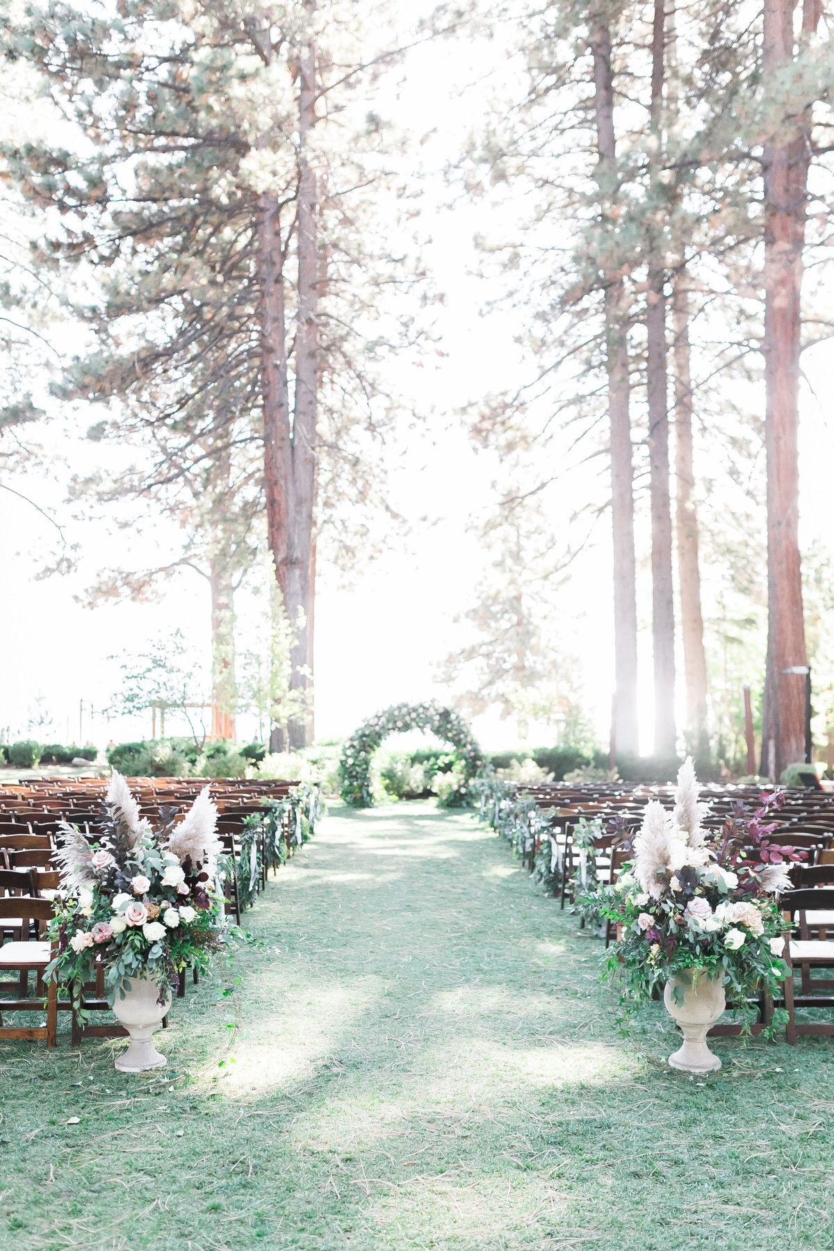 lakeside  wedding ceremony and arch at Hyatt Regency Lake Tahoe