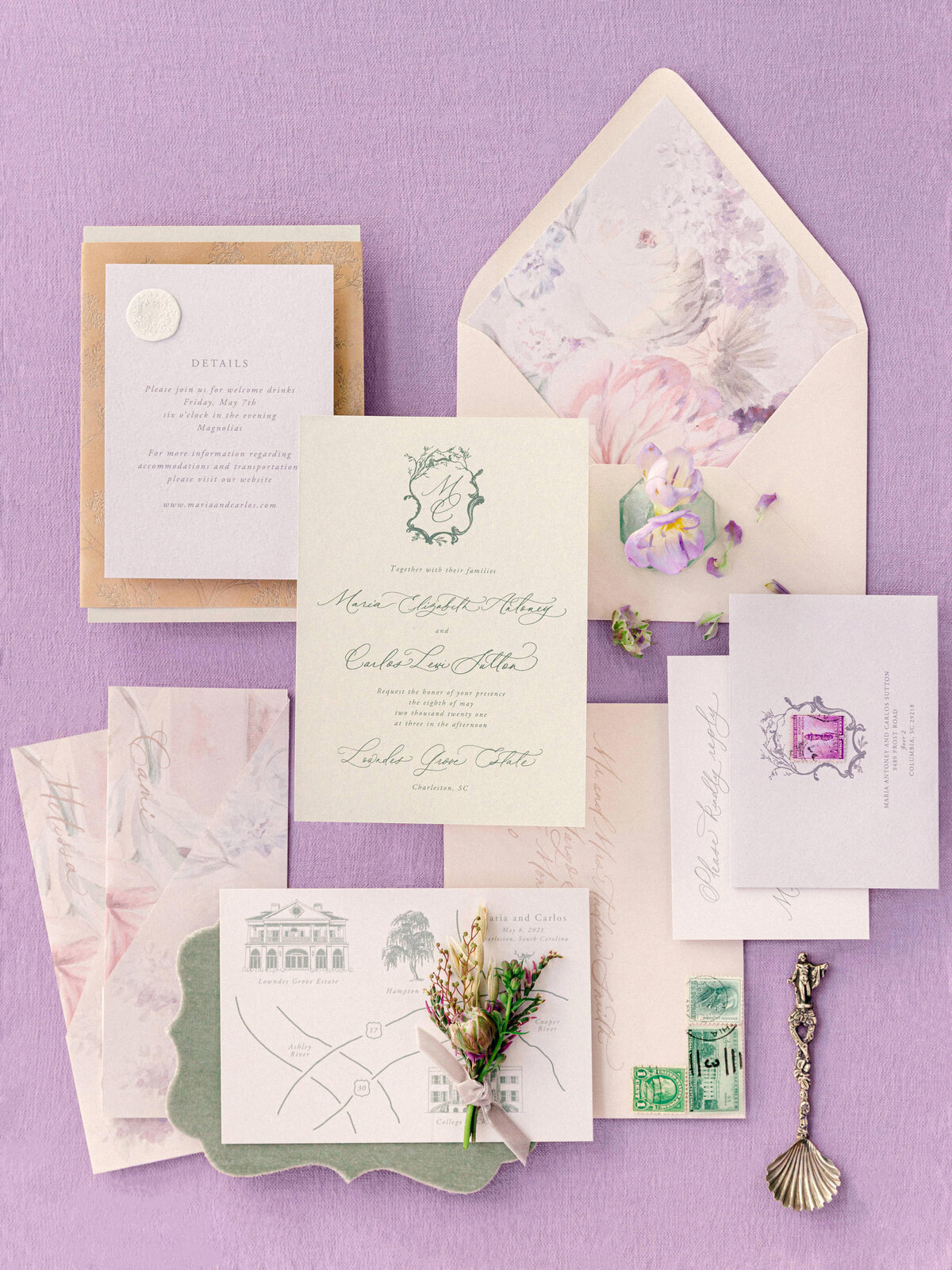 wedding paper invitation suite against purple background flatlay
