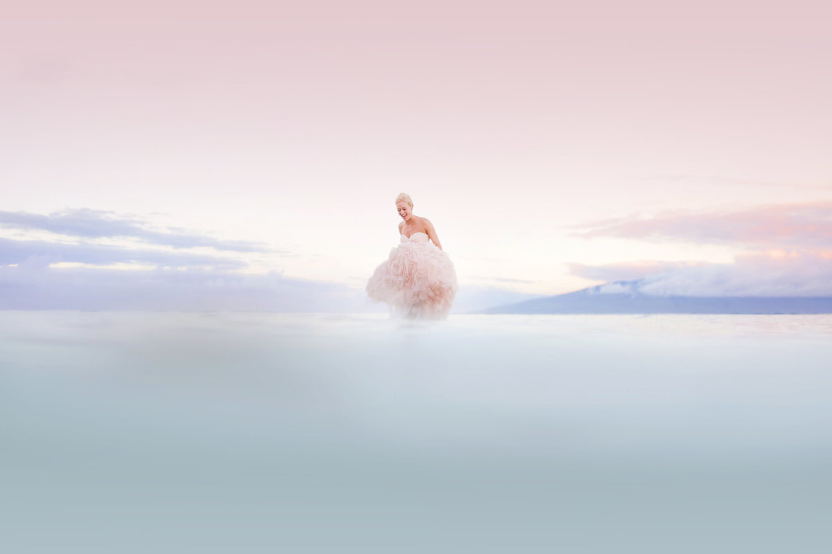 Maui trash the dress portrait of woman holding wedding dress in the water
