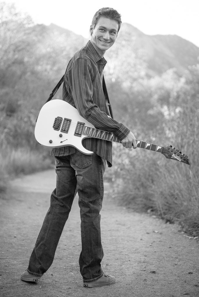 Boy with guitar at South Mesa Trail
