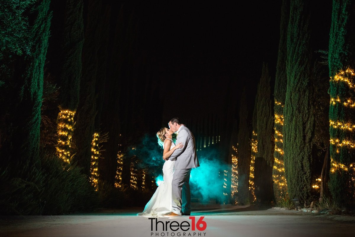 Night shot of Bride and Groom with blue background