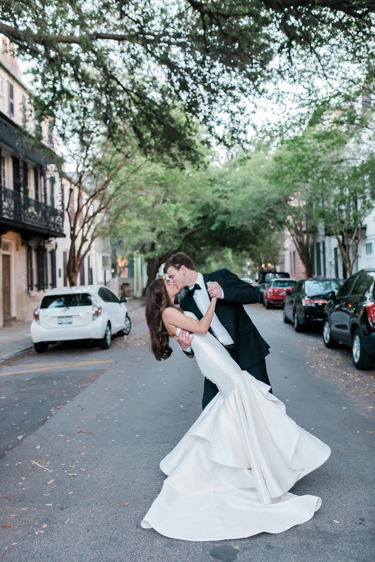 Bride and groom do a dip in the middle of the street in downtown Charleston, SC