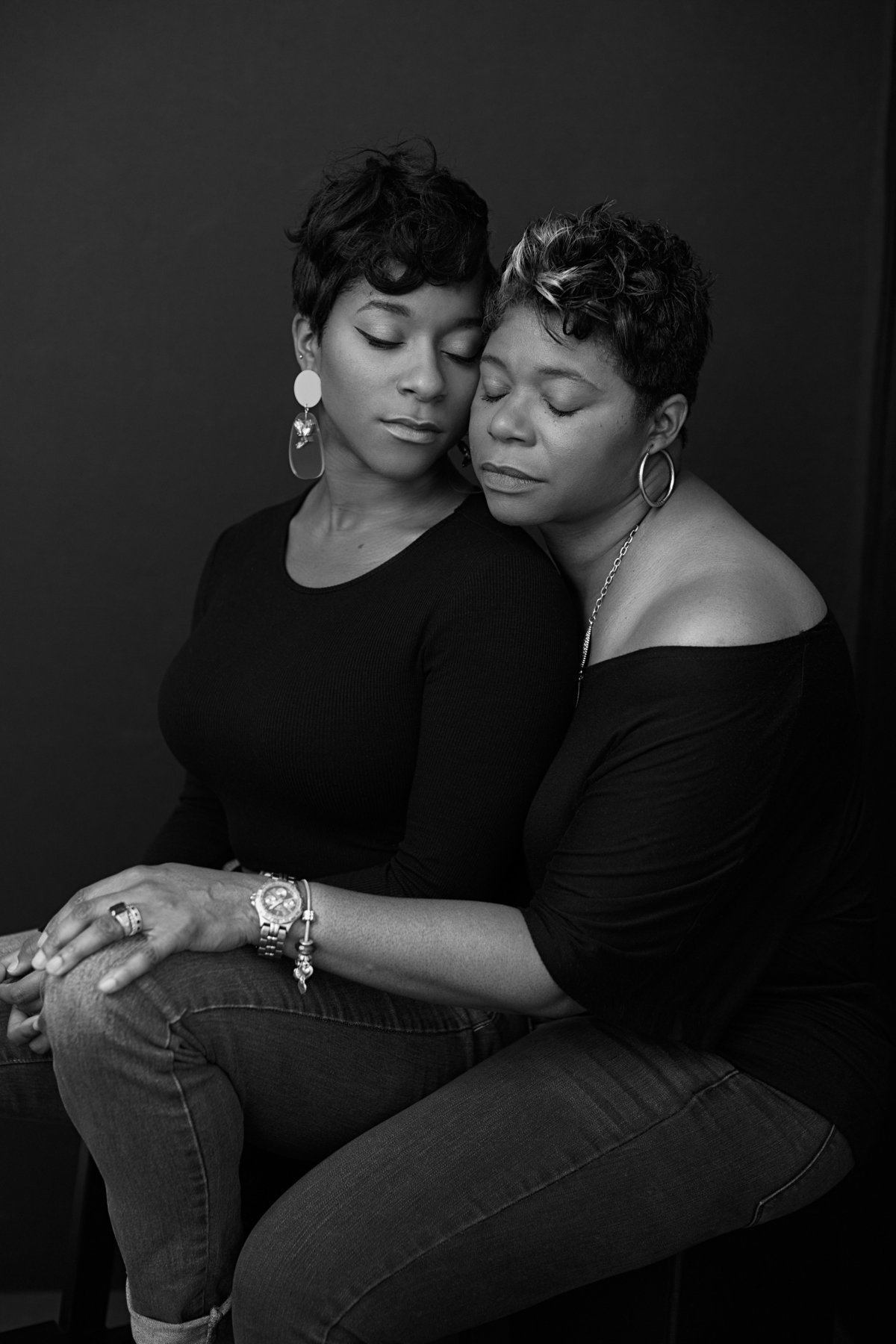 An African American black mother and daughter pose for a black and white image portrait for Janel Lee Photography studio in Cincinnati Ohio