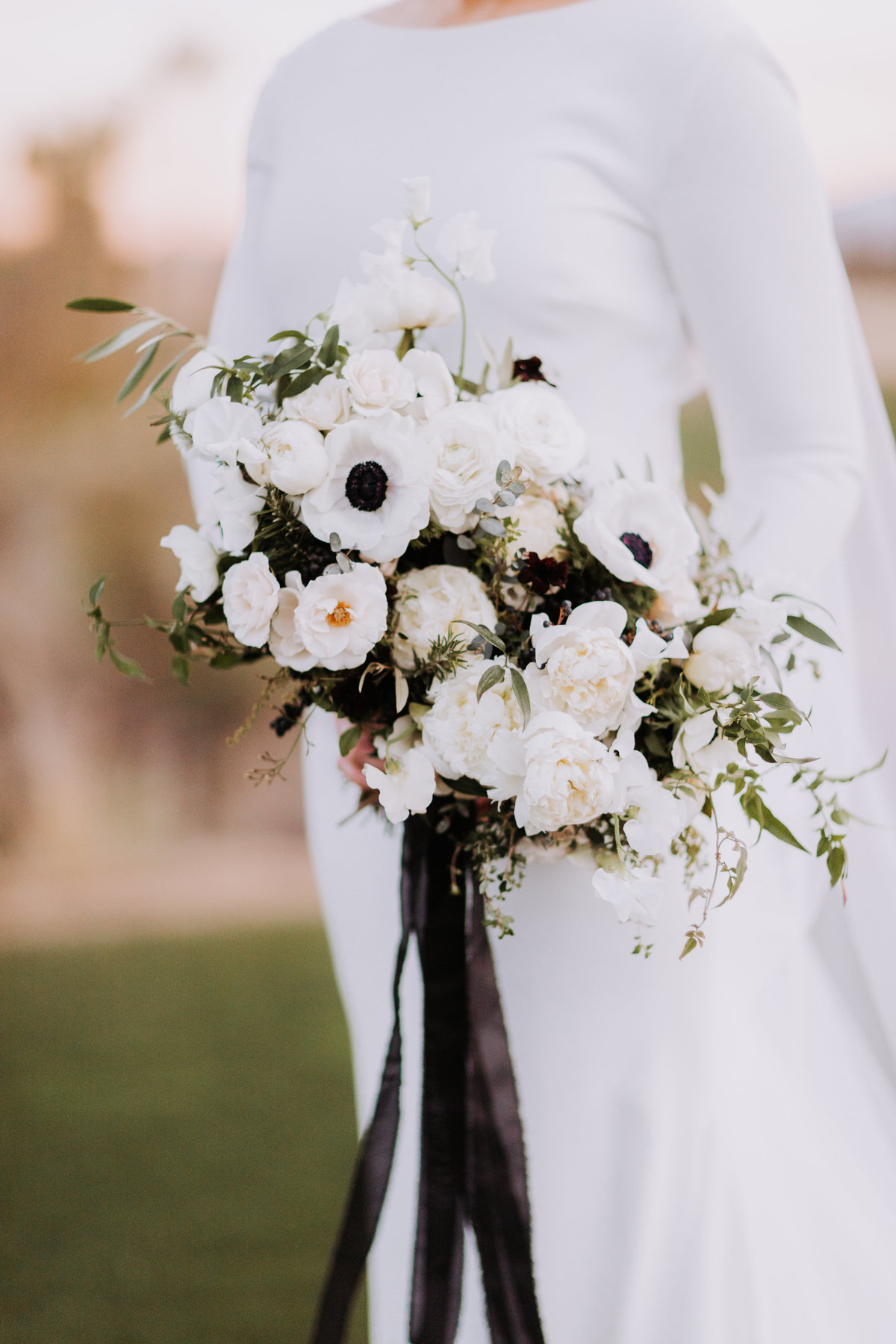 Lake Tahoe wedding pictures bride holds white floral display