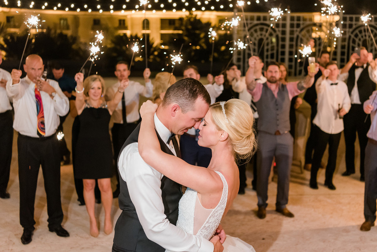 a bride and groom performing a dance surrounding sparklers at the JW Marriott Resort and Spa Las Vegas